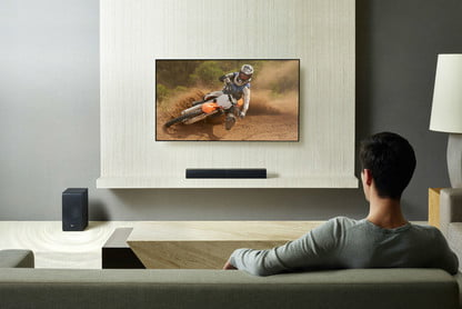 Man watching motorcycle race at his home theater
